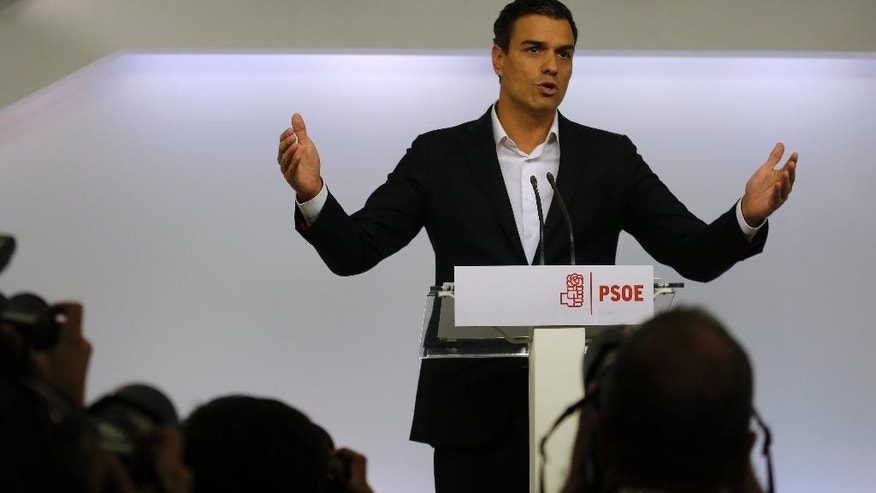 Spain's Socialist leader Pedro Sanchez gestures as he gives an statement during an appearance before the press in the party headquarters in Madrid, Spain, Friday Sept. 30, 2016.  A growing leadership battle has been raging within Spain's main opposition Socialist party and has threatened to tear the 137-year-old organization apart and hurl the country toward an unprecedented third election in a year.  The party will hold a crucial federal committee on Saturday  that may be unable to resolve the schism between those for and against leader Pedro Sanchez. (AP Photo/Francisco Seco)