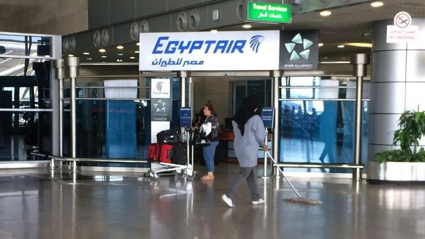 FILE - In this Thursday, May 19, 2016, file photo, the Egyptair logo is seen at the arrivals section of Cairo International Airport, Egypt. Egyptian Aviation officials said on Sunday they would soon announce a tender for a new security system for Cairo airport employees involving retina scans, attempting to meet a key Russian condition to resume flights to Egypt.  (AP Photo/Amr Nabil, File)