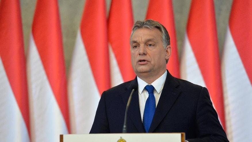 FILE - In this Feb. 24, 2016 file photo Hungarian Prime Minister Viktor Orban speaks during a press conference in Budapest, Hungary. Hungarians will vote Sunday, Oct. 2, 2016, in a referendum called by Orban's government, seeking political support against any future plans by the European Union to resettle refugees or asylum seekers among members of the bloc. (Szilard Koszticsak/ MTI via AP, file)