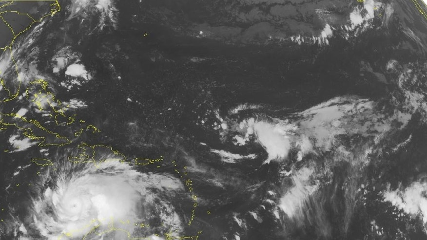 This NOAA satellite image taken Sunday, Oct. 2, 2016 at 12:45 AM EDT shows Hurricane Matthew, currently a category 4 hurricane with maximum sustained winds upwards of 150 MPH making its turn northward and towards Jamaica and Hispaniola. Matthew is currently 350 MI SSW of Port Au Prince, moving NNW at 6 MPH. Hurricane warnings have already been issued for Jamaica and Haiti as well. Matthew is expected to continually move north, currently forecasted to drift closer to Haiti than Jamaica, and retain its strength as it moves north towards the Bahamas.  (NOAA/Weather Underground via AP)