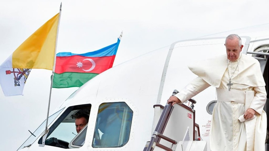 Pope Francis disembarks from a plane that brought him to Azerbaijan's capital Baku, Sunday, Oct. 2, 2016. Francis arrived in Azerbaijan on Sunday for a 10-hour visit aimed at encouraging the country's inter-religious harmony while likely overlooking recent criticism of a referendum that extends the president's term and powers. (L'Osservatore Romano/Pool Photo via AP)