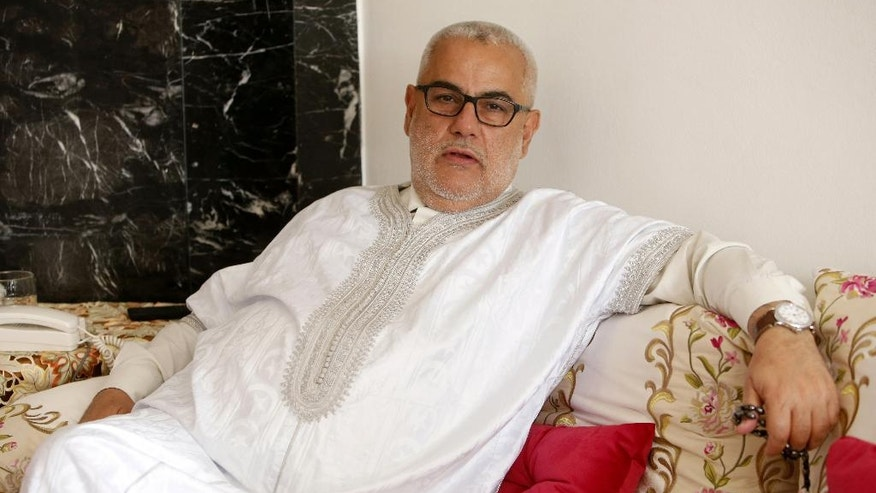Moroccan Prime Minister and leader of the Islamist Justice and Development Party, known as the PJD, Abdelilah Benkirane speaks about the upcoming nationwide legislative election, during an interview with The Associated Press at his home in Rabat, Monday, October 3, 2016. Voting booths open on Oct. 7 for the North African kingdom's parliamentary elections, in which 395 seats in the upper house of Parliament are up for grabs. (AP Photo/Abdeljalil Bounhar)