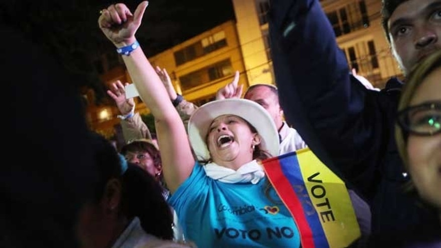 BOGOTA, COLOMBIA - OCTOBER 02: 'No' supporters celebrate at a rally following their victory in the referendum on a peace accord to end the 52-year-old guerrilla war between the FARC and the state on October 2, 2016 in Bogota, Colombia.