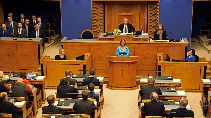 Kersti Kaljulaid speaks in the Estonian parliament in Tallinn, Estonia, Monday, Oct. 3, 2016. Estonia finally has chosen a new president, who will be the Baltic country's first female leader. After two failed votes and weeks of heated debate, lawmakers on Monday unanimously elected European Union accountant Kersti Kaljulaid. (AP Photo/Vitnija Saldava)