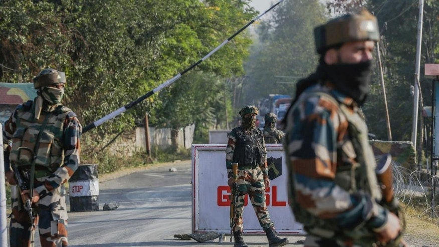 Indian army soldiers guard outside the base camp which was attacked by suspected militants at Baramulla, northwest of Srinagar, Indian controlled Kashmir, Monday, Oct. 3, 2016. A gun battle with a group of militants who attacked an Indian army camp in the Indian portion of Kashmir has ended early Monday morning, police said. (AP Photo/Mukhtar Khan)