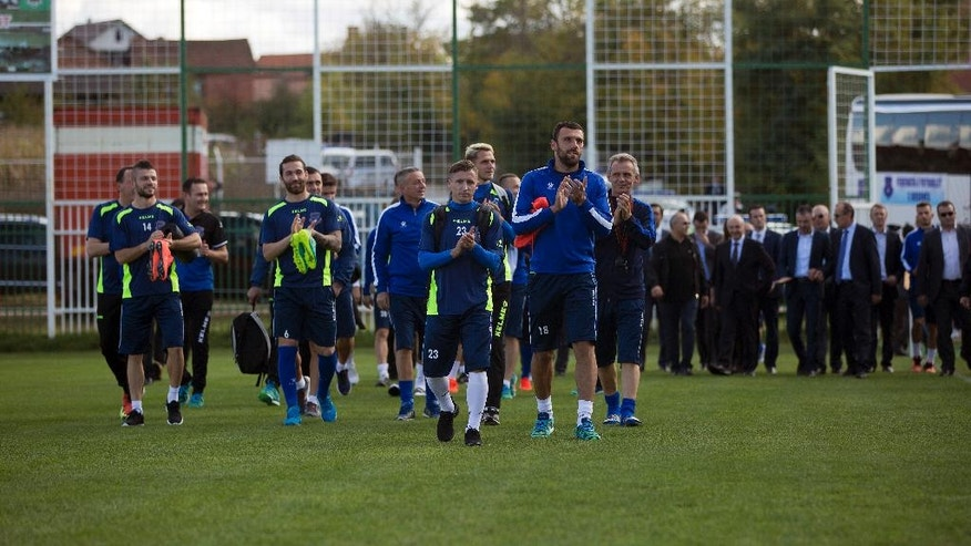 Kosovo's national soccer team arrives for a training session ahead of the World Cup Group I qualifying soccer match between Kosovo and Croatia at Feronikeli stadium in Drenas, Kosovo on Monday, Oct. 3, 2016. Kosovo was fast-tracked into the World Cup qualifiers after became a UEFA and FIFA member last May. Thursday's match against Croatia will be played in Albania's northern city of Shkodra as Kosovo has no stadium certified by UEFA. Three days later Kosovo travels to Ukraine. (AP Photo/Visar Kryeziu)