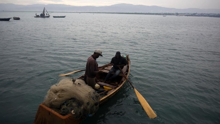 Fishermen head out to sea in Port-au-Prince, Haiti, Monday, Oct. 3, 2016. Major Hurricane Matthew is slowly churning northward across the Caribbean and meteorologists say the powerful storm is expected to approach Jamaica and southwest Haiti by Monday night. (AP Photo/Dieu Nalio Chery)