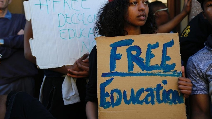"Students from the University of Cape Town, UCT, protest on their campus demonstrating for free education  in Cape Town, South Africa, Monday, Oct. 3,  2016. A South African Education Minister Blade Nzimande said Monday a small minority of university students is trying to spread ""anarchy"" with violent protests calling for free education. (AP Photo/Schalk van Zuydam)"