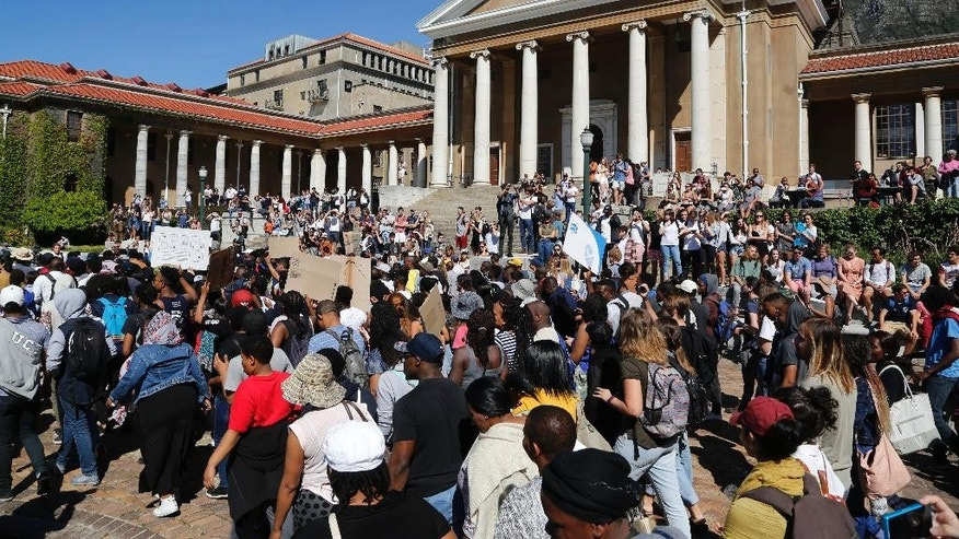 "Students from the University of Cape Town, UCT, march on their campus demonstrating for free education in Cape Town, South Africa, Monday, Oct. 3,  2016. A South African Education Minister Blade Nzimande said Monday a small minority of university students is trying to spread ""anarchy"" with violent protests calling for free education. (AP Photo/Schalk van Zuydam)"