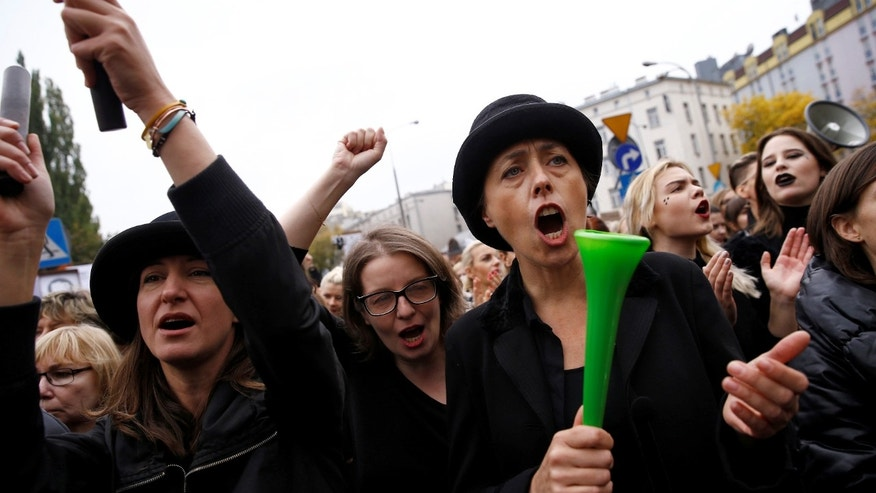 Women shout slogans as they protest a proposed ban on abortion in Poland.