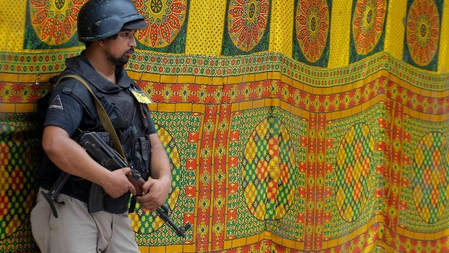 A Pakistani police commando stands guard outside a tent during Shiite Muslims' congregation during the mourning month Muharrum in Peshawar, Pakistan, Tuesday, Oct. 4, 2016. Authorities are taking extra precautionary measures to avert any terrorist attempt during Muharram, the first month of the Islamic calendar, which is observed around the world for ten days of mourning in remembrance of the martyrdom of Imam Hussein, the grandson of Prophet Mohammed. (AP Photo/K.M. Chaudary)