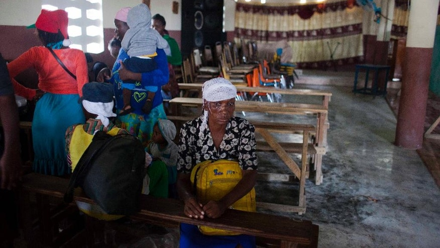 Residents rest in a Church after been evacuated from the area near the Grise river prior the arrival of Hurricane Matthew, in Tabarre, Haiti, Monday, Oct. 3, 2016. The center of Hurricane Matthew is expected to pass near or over southwestern Haiti on Tuesday, but the area is already experiencing rain from the outer bands of the storm. (AP Photo/Dieu Nalio Chery)