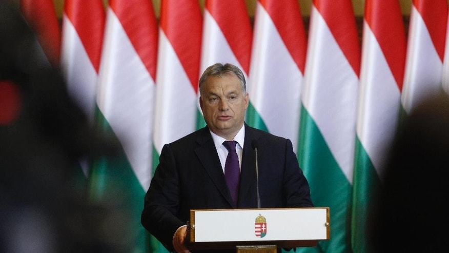 Hungarian Prime Minister Viktor Orban speaks during a press conference concerning the referendum held in Hungary last Sunday on the European Commission's proposed mandatory resettlement of migrants in member states of EU following an extraordinary session of the faction of the Fidesz party in the Parliament in Budapest, Hungary, Tuesday, Oct. 4, 2016. (Zsolt Szigetvary/MTI via AP)