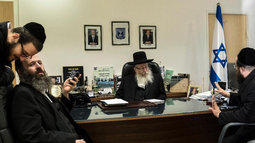 In this photo taken Wednesday, Sept. 7, 2016, Israeli Health Minister Yaakov Litzman speaks during an interview with the Associated Press in is office in Jerusalem. As the senior representative of ultra-Orthodox Jews in Israeli government, Health Minister Yaakov Litzman is unapologetic about the insular lifestyle he advocates and which has long irked mainstream Israel and endangered its long-term economic prospects. A new generation of Israeli ultra-Orthodox Jews is looking to defy stereotypes and reform the community by demanding academic degrees, satisfying professions and greater immersion in Israeli society. But their leadership remains unapologetic about advocating for an insular lifestyle that has long irked mainstream Israel and endangered the country's long-term economic prospects. (AP Photo/Tsafrir Abayov)