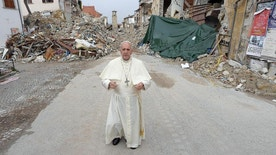"""Pope Francis stands in front of rubble, with the standing bell tower in the background, of the quake-struck town of Amatrice, Italy, Tuesday, Oct. 4, 2016. Francis had made clear his intentions to visit the August quake-stricken zone in central Italy, but without announcing a date, indicating that he wanted to go alone """"to be close to the people."""" (L'Osservatore Romano/ Pool Photo via AP)"""