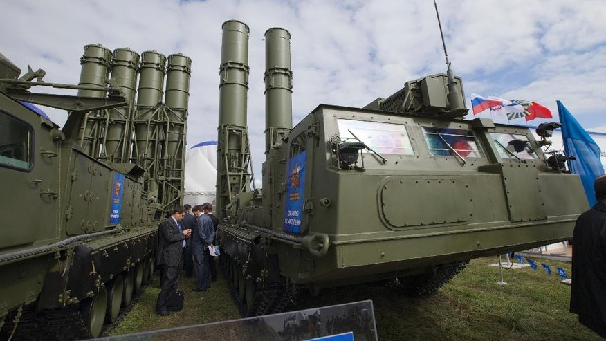 FILE - In this Tuesday, Aug. 27, 2013 file photo, Russian air defense system missile system Antey 2500, or S-300 VM, is on display at the opening of the MAKS Air Show in Zhukovsky outside Moscow, Russia. The Russian military said Tuesday it had deployed the S-300 air defense missile systems to Syria to protect a Russian navy facility in the Syrian port of Tartus and Russian navy ships in the area. (AP Photo/Ivan Sekretarev, file)