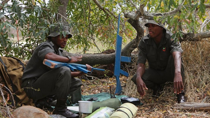 In this photo taken Saturday, Oct. 1, 2016, recruits at the Southern African Wildlife College on the edge of Kruger National Park in South Africa explain conditions in the wild during their attempts to track poachers. As teams of poachers stalk rhinos and elephants in the park, wildlife officials are turning to nearby communities to help stop the slaughter by using local knowledge to deter poachers, not join them. (AP Photo/Denis Farrell)