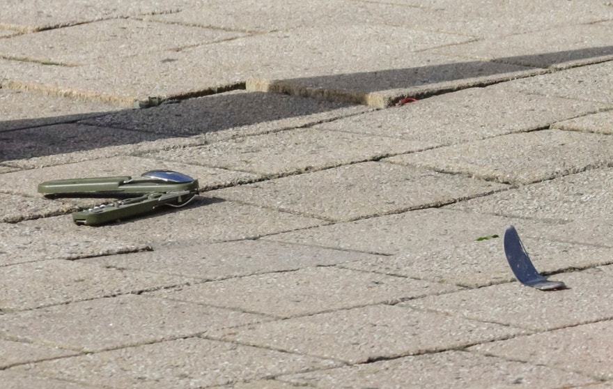 A knife lies on the ground at  the scene where an unidentified man stabbed two police officers, in the Schaerbeek neighborhood in Brussels, Wednesday, Oct. 5, 2016. (AP Photo/Olivier Matthys)