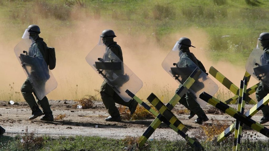 """Soldiers take part in the military exercise """"Quick Response 2016"""" at fire range Manjaca near Banja Luka, 300 kms west of Sarajevo, Bosnia, Wednesday, Oct. 5, 2016. Over 750 Soldiers from EUFOR, Armed Forces of Bosnia and Herzegovina , United Kingdom, Austria, Portugal and Hungary participate in the exercise, which is  the annual test for EUFOR to call forward their Immediate Reserve Forces in order to be prepared should the authorities of BIH request their assistance. (AP Photo/Amel Emric)"""
