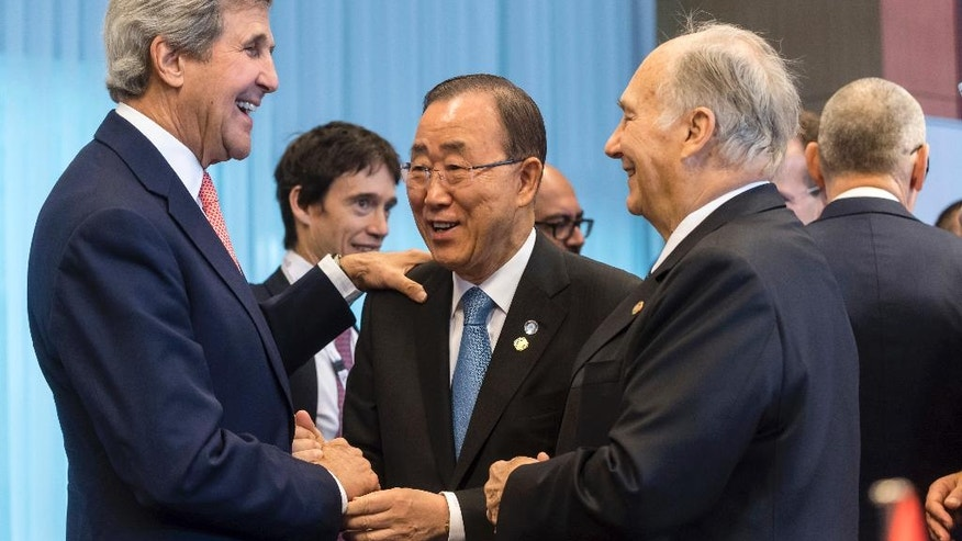 U.S. Secretary of State John Kerry, left, talks with U.N. Secretary-General Ban Ki-moon, center, and Prince Aga Khan during a Conference on Afghanistan in Brussels, Wednesday, Oct. 5, 2016. The two-day conference, hosted by the EU, will have the participation of over 70 countries to discuss the current situation in Afghanistan. (AP Photo/Geert Vanden Wijngaert)