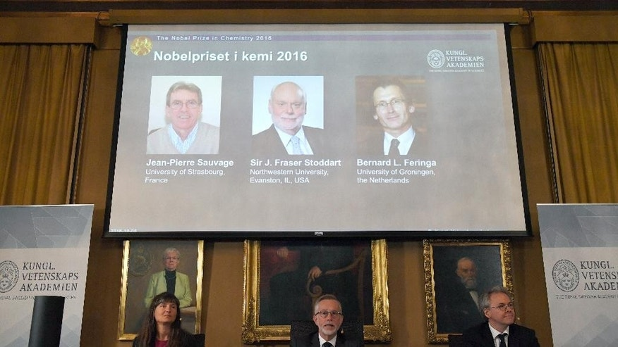 The Royal Academy of Sciences members, from left to right, Professor Sara Snogerup Linse, Professor Goran K Hansson and Professor Olof Ramstrom present the 2016 Nobel Chemistry Prize at the Royal Swedish Academy of Sciences, in Stockholm, Sweden, Wednesday, Oct. 5, 2016. Jean-Pierre Sauvage, Fraser Stoddart and Bernard Feringa have been awarded the Nobel chemistry prize. (Henrik Montgomery /TT via AP)