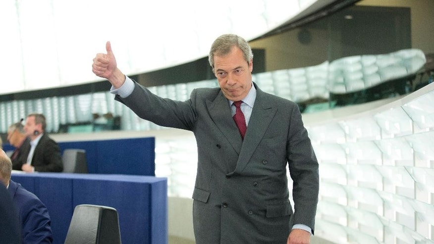 Nigel Farage,  former leader of the UK Independence Party and member of the European Parliament, gives a thumbs up as he arrives to attend a session at the European Parliament in Strasbourg, eastern France, Wednesday, Oct. 5, 2016. (AP Photo/Jean-Francois Badias)