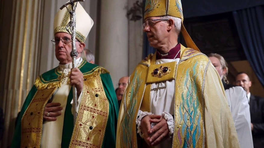 Pope Francis, left, and the Archbishop of Canterbury, Justin Welby, arrive for vespers prayers in the church of San Gregorio al Celio, in Rome, Wednesday, Oct. 5, 2016. (AP Photo/Gregorio Borgia)