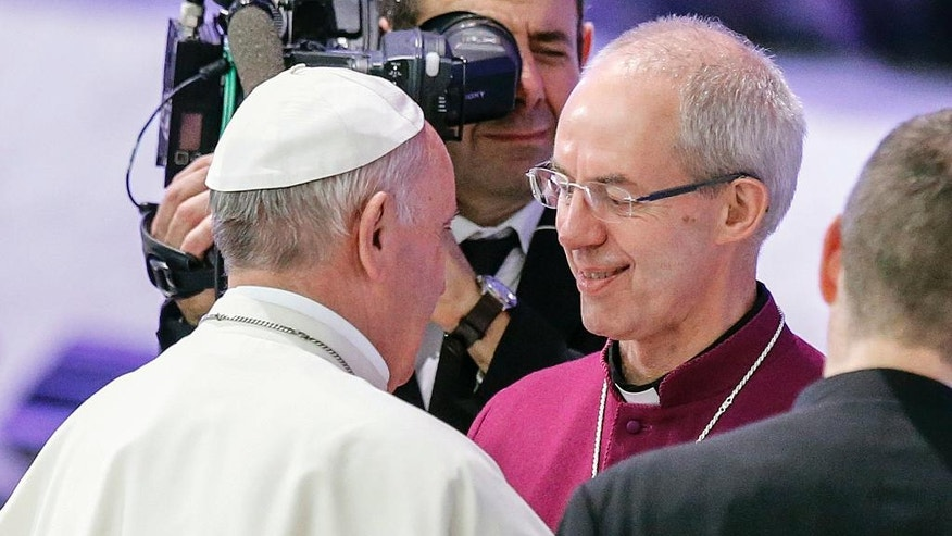 "Pope Francis greets Archbishop of Canterbury, Justin Welby, during the opening ceremony of the 1st international conference on sports and faith "" Sport at the Service of Humanity"", the first global conference on faith and sport promoted by the Vatican Pontifical Council for Culture, in the Paul VI hall at the Vatican, Wednesday, Oct. 5 ,2016.  (AP Photo/Fabio Frustaci)"
