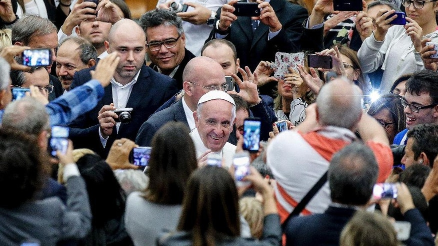 "Pope Francis arrives for the opening ceremony of the international conference on sports and faith "" Sport at the Service of Humanity"", the first global conference on faith and sport promoted by the Vatican Pontifical Council for Culture, in the Paul VI hall at the Vatican, Wednesday, Oct. 5 ,2016.  (AP Photo/Fabio Frustaci)"