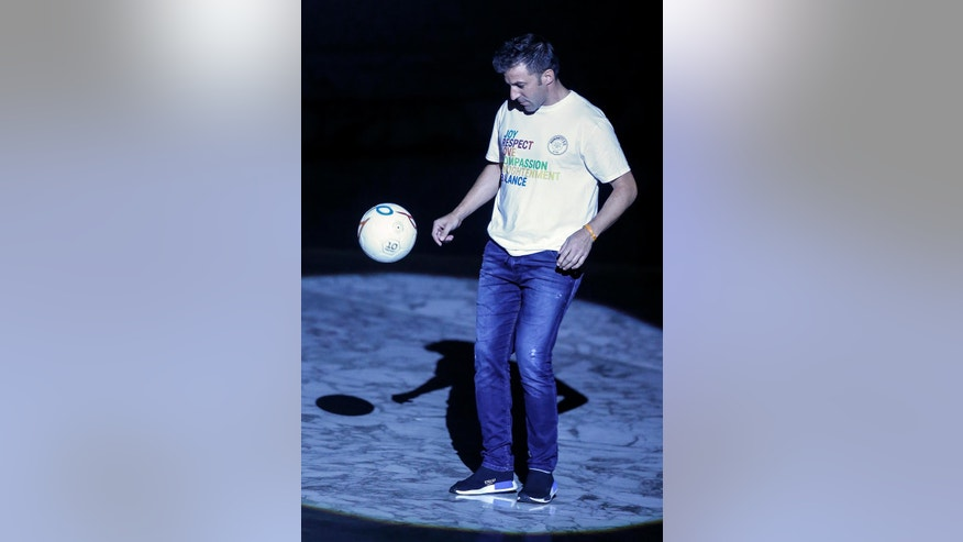 """Former Italian soccer player Alessandro Del Piero plays with a ball during the opening ceremony of the 1st international conference on sports and faith """" Sport at the Service of Humanity"""", the first global conference on faith and sport promoted by the Vatican Pontifical Council for Culture, in the Paul VI hall at the Vatican, Wednesday, Oct. 5 ,2016.  (AP Photo/Fabio Frustaci)"""