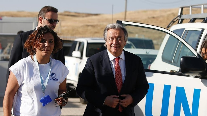 FILE - In this June 20, 2015 file photo, U.N. High Commissioner for Refugees Antonio Guterres, right, arrives for a visit at the Midyat refugee camp in Mardin, southeastern Turkey, near the Syrian border, Saturday, June 20, 2015. Gutierrez visited the camp which is sheltering those who have fled the 4-year conflict in neighbouring Syria, on the World Refugee Day. The U.N. Security Council will meet on Thursday, Oct. 6, 2016, to formally approve Guterres as the next U.N. secretary-general and recommend his candidacy to the 193-member General Assembly, which must give final approval. (AP Photo/Emrah Gurel, File)