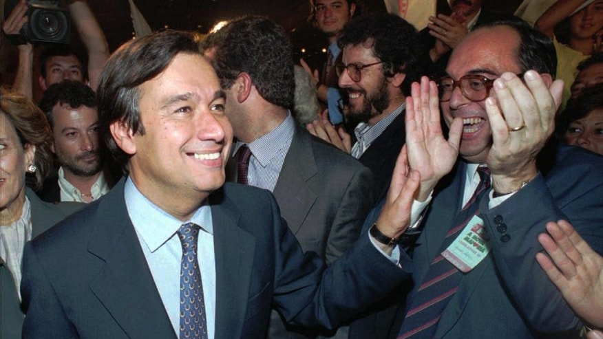 FILE - In this Oct. 1, 1995 file photo, Portuguese Socialist Party leader Antonio Guterres is cheered by supporters as he leaves a Lisbon hotel after his party won the Portuguese general elections, ending 10 years of Social Democratic rule. The U.N. Security Council will meet on Thursday, Oct. 6, 2016, to formally approve Guterres as the next U.N. secretary-general and recommend his candidacy to the 193-member General Assembly, which must give final approval. (AP Photo/Santiago Lyon, File)