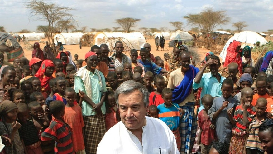 FILE - In this July 10, 2011 file photo, U.N. High Commissioner for Refugees Antonio Guterres is surrounded by Somali refugees as he speaks to the media in an area where recent arrivals from Somalia have settled, on the outskirts of Dagahaley Camp, outside Dadaab, Kenya. The U.N. Security Council will meet on Thursday, Oct. 6, 2016, to formally approve Guterres as the next U.N. secretary-general and recommend his candidacy to the 193-member General Assembly, which must give final approval. (AP Photo/Rebecca Blackwell, File)