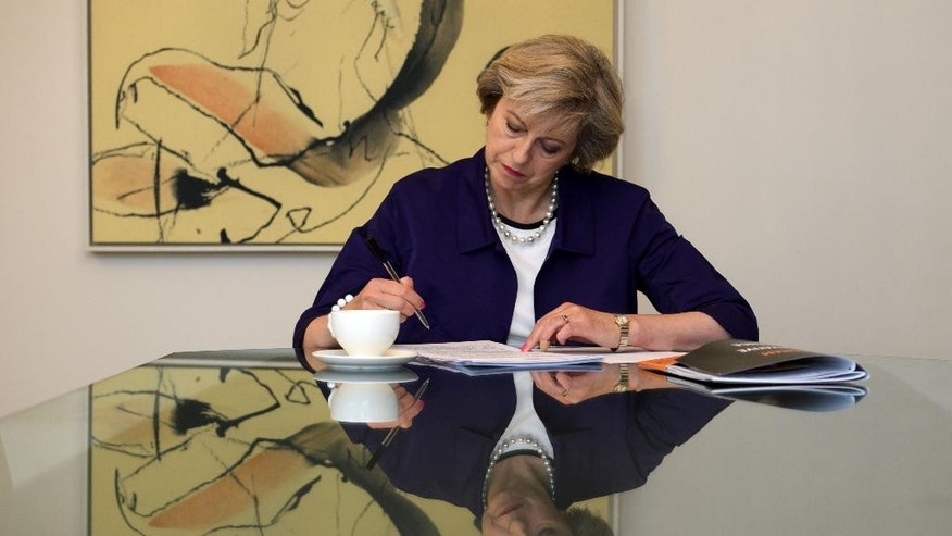 Britain's Prime Minister, Theresa May, in her hotel room in Birmingham, central England, Tuesday Oct. 4, 2016, as she prepares her conference speech that she will deliver to the Conservative party conference being held at the ICC in Birmingham. (Carl Court/PA via AP)