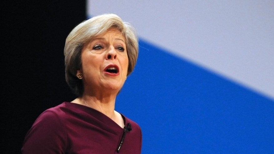 "Conservative Party Leader and Prime Minister Theresa May addresses delegates during a speech at the Conservative Party Conference at the ICC, in Birmingham, England, Wednesday, Oct. 5, 2016. May has vowed to govern from the ""center ground"" of politics, a day after her government alarmed liberals by saying that businesses should prioritize hiring British workers over foreign ones. (AP Photo/Rui Vieira)"