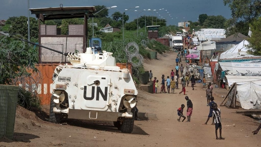FILE - In this Monday, July 25, 2016 file photo, a United Nations armoured personnel vehicle stands in a refugee camp in Juba South Sudan. A new report says United Nations peacekeepers fled their posts when fighting erupted in South Sudan's capital in July, then used tear gas on frightened civilians who sought shelter within the U.N. base. The report on Wednesday, Oct. 5, 2016 by the U.S.-based Center for Civilians in Conflict adds to a growing list of incidents where peacekeepers have been accused of failing to carry out their mandate in South Sudan.(AP Photo/Jason Patinkin/File)
