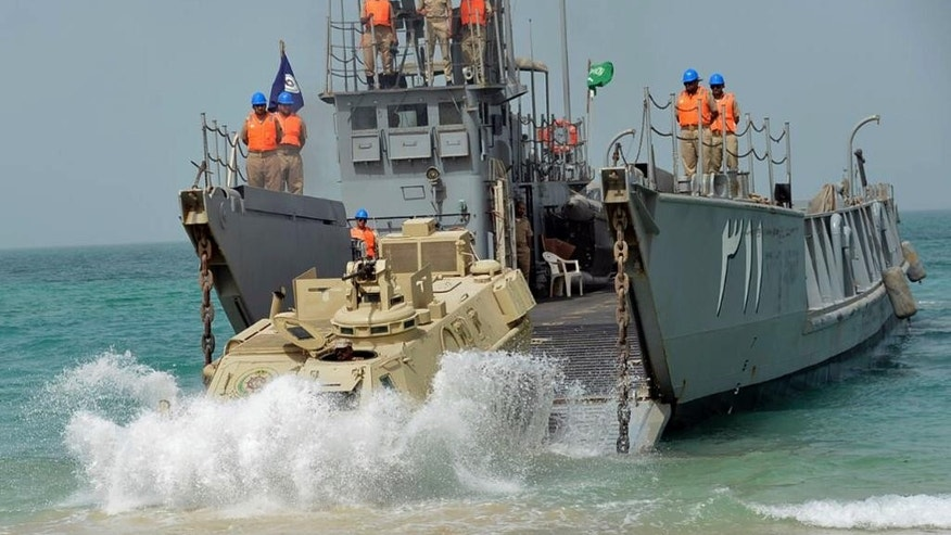 "In this undated photo released by Saudi Press Agency, SPA, the Royal Saudi Navy conducts military exercises dubbed Gulf Shield One in the Strait of Hormuz and the Sea of Oman. As Saudi Arabia holds a naval drill in the strategic Strait of Hormuz, a powerful Iranian general has been quoted as suggesting the kingdom's deputy crown prince is so ""impatient"" he may kill his own father to take the throne. While harsh rhetoric has been common between the two rivals since January, the outrageous comments by Revolutionary Guard Gen. Qassem Soleimani take things to an entirely different level by outright discussing Saudi King Salman being killed. (Saudi Press Agency via AP)"