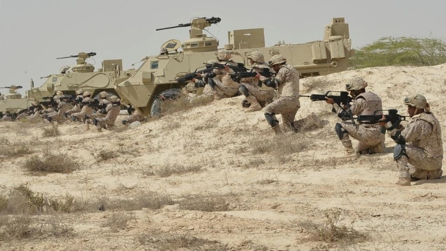 "In this undated photo released by Saudi Press Agency, SPA, Saudi military personnel conduct military exercises dubbed Gulf Shield One in Saudi Arabia. As the Saudis holds a naval drill in the strategic Strait of Hormuz, a powerful Iranian general has been quoted Wednesday, Oct. 5, 2016, as suggesting the kingdom's deputy crown prince is so ""impatient"" he may kill his own father to take the throne. While harsh rhetoric has been common between the two rivals since January, the outrageous comments by Revolutionary Guard Gen. Qassem Soleimani take things to an entirely different level by outright discussing Saudi King Salman being killed. (Saudi Press Agency via AP)"