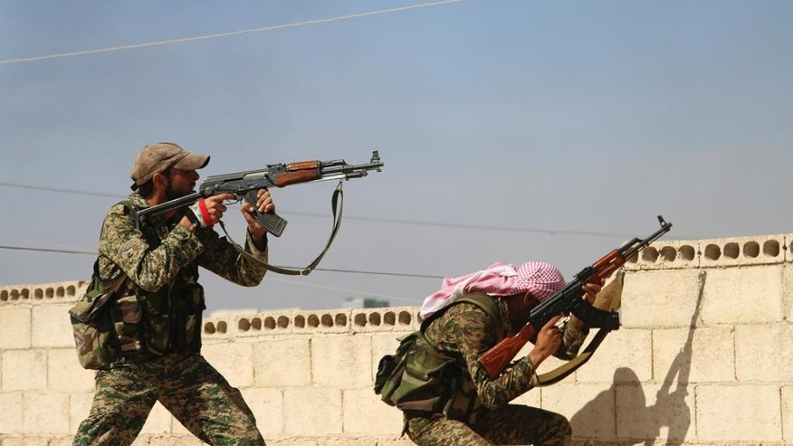 FILE - In this Oct. 11, 2015 file photo, Syrian soldiers fire repelling an attack in Achan, Hama province, Syria. he battle for Aleppo has gripped the world, but it is hardly the only front in Syria: Opposition forces are on the offensive in the country's center hoping to sever the road connection between Aleppo and the capital Damascus, which is itself a front; in the northwest, Turkish-backed opposition forces battle  Islamic State militants; to the east, government forces weather an Islamic State siege of Deir El-Zour.  (Alexander Kots/Komsomolskaya Pravda via AP, File)