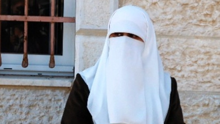 A Muslim woman wears a face covering similar to the type Norway is trying to ban in schools and universities.