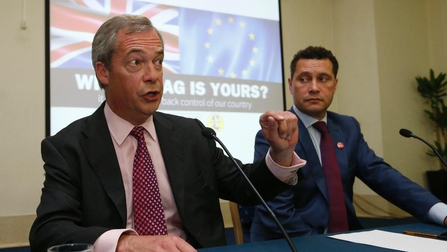 "FILE - In this Wednesday, June 22, 2016 file photo, UK Independence Party's Steven Woolfe, a Member of the European Parliament, right, listens as then leader of the party Nigel Farage speaks at the final press conference to the referendum on Britain's vote to leave or remain in the EU, in London. Britain's right-wing U.K. Independence Party says one of its European Parliament members is in serious condition in a hospital after an 'altercation' with colleagues. Party leader Nigel Farage said Thursday, Oct. 6, 2016 that ""following an altercation that took place at a meeting of UKIP MEPs this morning ... Steven Woolfe subsequently collapsed and was taken to hospital. His condition is serious.""  (AP Photo/Alastair Grant, File)"