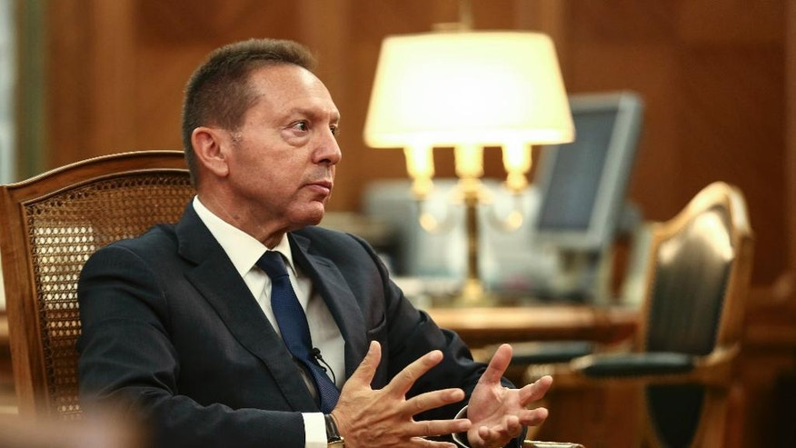 """Bank of Greece Governor Yannis Stournaras gestures during an interview with the Associated Press in Athens, on Friday, Oct. 7, 2016. European Central Bank governing council member Yannis Stournaras says the effect of Britain leaving the European Union single market on the continent's eurozone economy will """"not be that important"""", and it will be the UK economy that suffers the most.  (AP Photo/Yorgos Karahalis)"""