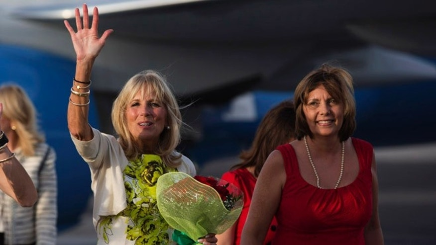 Dr. Jill Biden, wife of United States Vice President Joe Biden, waves as she walks next to the Director General of the U.S. division at Cuba's Foreign Ministry, Josefina Vidal, right, on the tarmac of Jose Marti International Airport in Havana, Cuba, Thursday, Oct. 6, 2016. Biden is on a three day visit to Cuba. (Ismael Francisco/Cubadebate via AP)