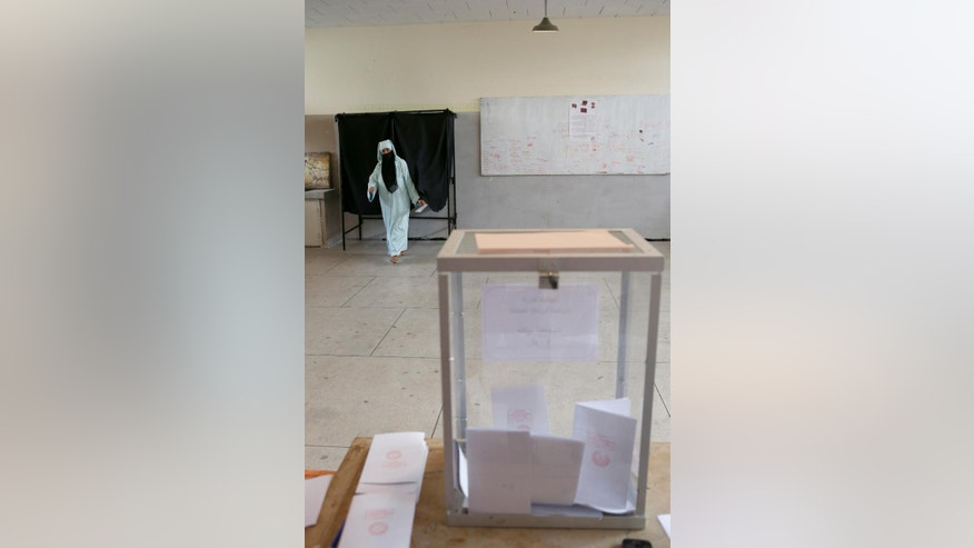 A Moroccan woman arrives to cast her ballot at a polling station for the parliamentary elections, in  Rabat, Morocco, Friday, Oct. 7, 2016. Millions of Moroccans hit the voting booths, with worries about joblessness and extremism on many minds as they choose which party will lead their next government.(AP Photo/Abdeljalil Bounhar)