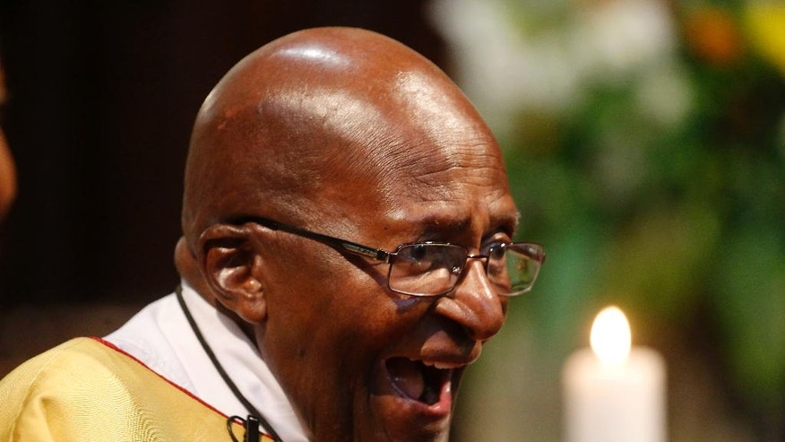 Anglican Archbishop Emeritus Desmond Tutu reacts during a church service at the St. George's Cathedral as he celebrates his 85th birthday in Cape Town, South Africa, Friday, Oct. 7, 2016.  (AP Photo/Schalk van Zuydam)