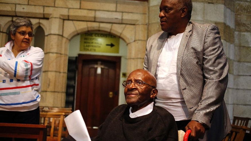Anglican Archbishop Emeritus Desmond Tutu, center,  arrives for a church service at the St. George's Cathedral, as he celebrates his 85th birthday in Cape Town, South Africa, Friday, Oct. 7 2016.  (AP Photo/Schalk van Zuydam)