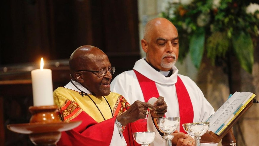 Anglican Archbishop Emeritus Desmond Tutu, left, gives mass during a church service at the St. George's Cathedral as he celebrates his 85th birthday in Cape Town, South Africa, Friday, Oct. 7, 2016. (AP Photo/Schalk van Zuydam)