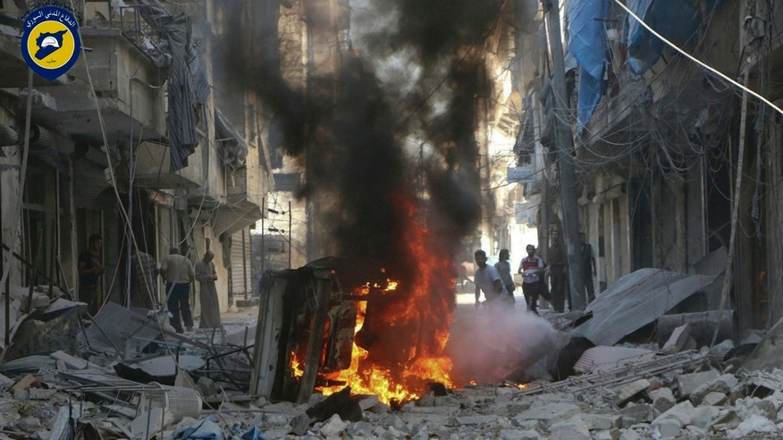 Syrians inspect damage after a government airstrike in Aleppo