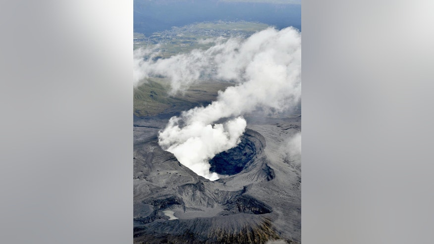 In this aerial view, plumes of white smoke rise from Mount Aso Nakadake Crater in Kumamoto Prefecture, southern Japan, Saturday morning, Oct. 8, 2016 following eruptions earlier in the day. Mount Aso has sent huge plumes of gray smoke as high as 11 kilometers (6.8 miles) into the air in one of the volcano's biggest explosions in years. (Hiroko Harima/Kyodo News via AP)