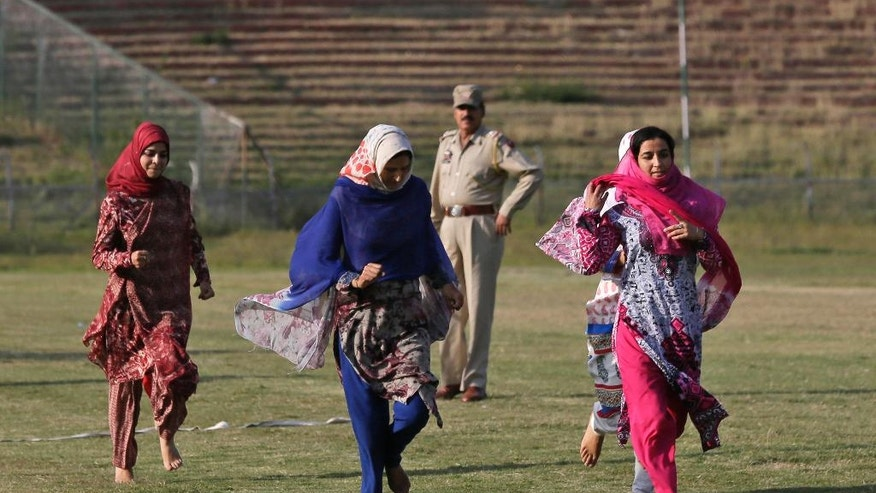 In this Thursday, Sept. 29, 2016 photo, Kashmiri women run during a physical fitness test for a police recruitment drive in Srinagar, Indian controlled Kashmir. Some 20,000 young people who are trying out for 8,000 jobs advertised by the state police, in the troubled Himalayan region that is wracked by rampant unemployment. But being a policeman in Indian-controlled Kashmir is both shameful and dangerous, a place where anti-India sentiments are high.  (AP Photo/Mukhtar Khan)